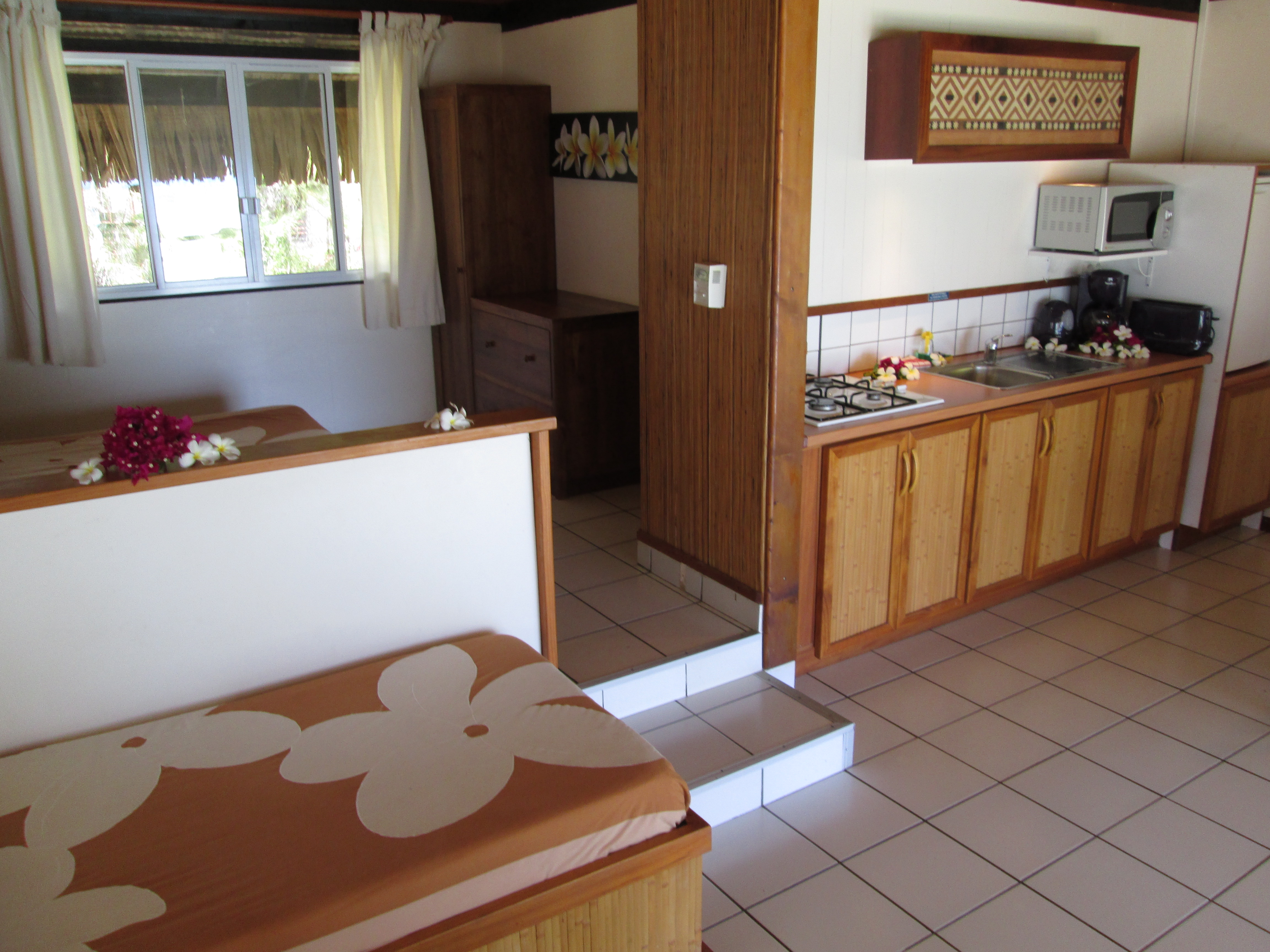 INTERIOR OF GARDEN BUNGALOW WITH KITCHEN AND BEACH BUNGALOW WITH KITCHEN